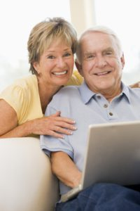 An older couple using a laptop.