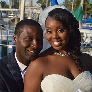 Hygienist Maria and her husband Keith smiling loud and proud for their wedding day