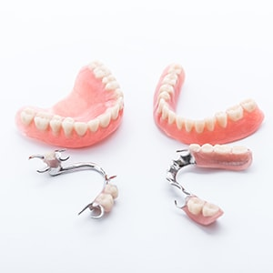 Different parts of custom fit dentures that we offer as part of our cosmetic dentistry services in Waldorf, MD