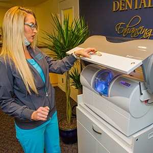 A team member using the CEREC machine