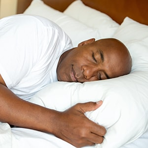 A man sleeping after curing his sleep apnea