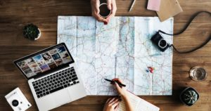 Couple with map planning for vaccines when traveling