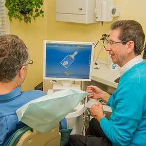 Dr. Paul Silberman showing a patient about CEREC same-day crowns