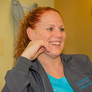 Our dental hygienist smiling, talking to a patient
