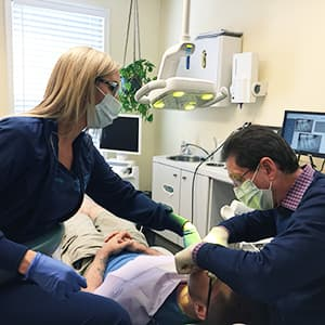 Dr. Silberman giving a patient a metal-free filling - a part of a general dentistry services in Waldorf, MD