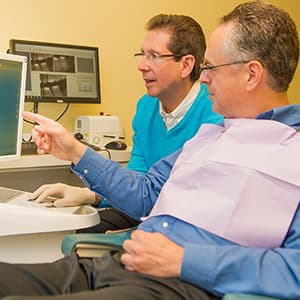 Dr. Silberman talking to a patient about same-day crowns