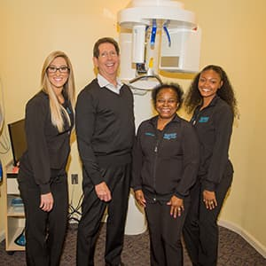 The Silberman Dental Group team smiling at the camera