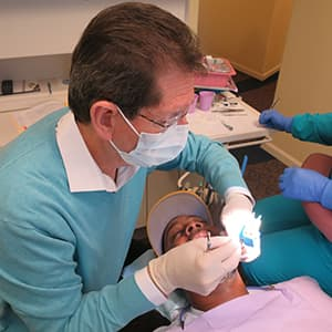 Dr. Silberman about to give a tooth extraction for a patient