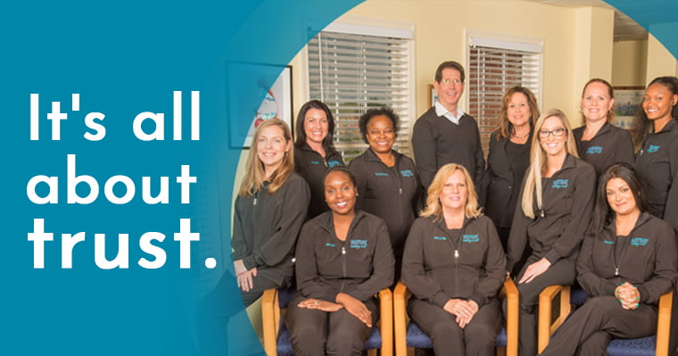 Dr. Silberman and his dental team with the text: It's all about trust