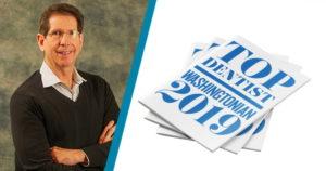 Dr. Silberman and the Washingtonian's Top Dentist award badge