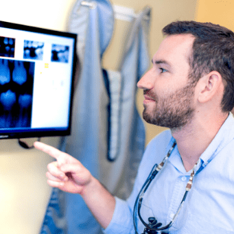 Dr. Barakh reviewing a patient's x-ray to create a custom treatment plan