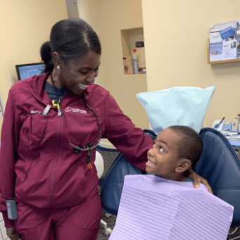 RSD, Mece, smiling at a young boy patient