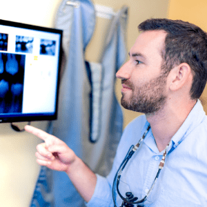 Dr. Barakh looking at x-rays