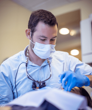 Dr. Daniel Barakh, a dentist in Waldorf, MD, working on a patient's smile