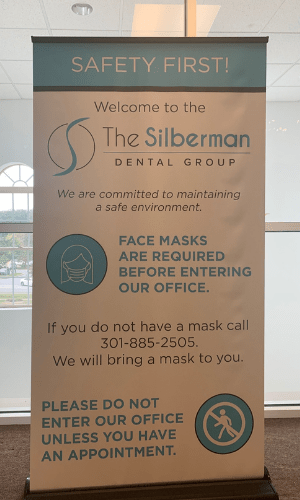A sign outside our office stating you need to wear a mask.